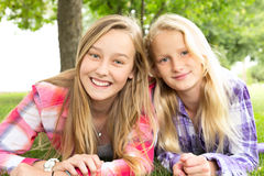Two girls laying on grass Royalty Free Stock Photography