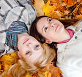 Two girls in leaves Royalty Free Stock Images