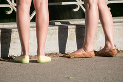 Two girls legs Stock Photography
