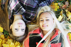 Two girls lie on the grass Royalty Free Stock Image