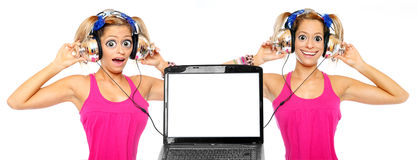 Two girls listening a music from laptop. Funny picture of two girls with a headphones listening a music from a laptop. Picture with space for a text or image royalty free stock images
