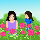 Two Girls. Two little girls are looking over a flower hedge Royalty Free Stock Photography