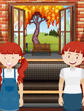 Two girls in the living room Stock Image