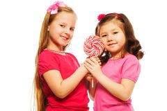 Two girls with lollipop Stock Images