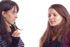 Two girls with lollypop Stock Photo