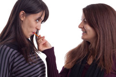 Two girls with lollypop Stock Photography