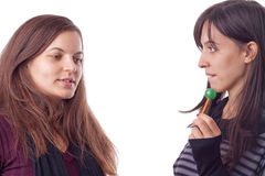Two girls with lollypop Royalty Free Stock Images