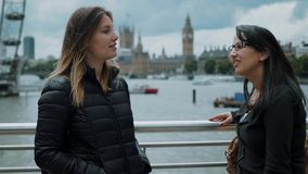Two girls in London - having fun on a sightseeing trip stock video