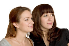 Two girls look aside. Royalty Free Stock Photography