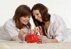 Two girls look at the makeup Royalty Free Stock Photos