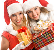 Two Girls Looking at Christmas Magic Present. Stock Photo