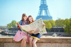 Two girls looking for direction in Paris Stock Photo
