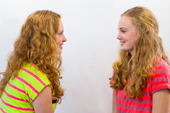 Two girls looking at each other Stock Image
