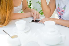 Two girls looking at mobile phone. royalty free stock image