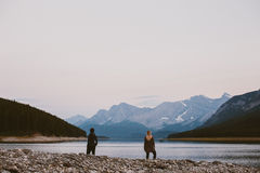 Two girls looking out at the lake Stock Images