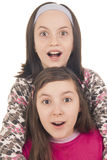 Two girls looking surprised Royalty Free Stock Photos