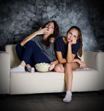 Two girls looks TV Stock Photos