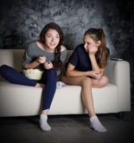 Two girls looks TV Royalty Free Stock Photography