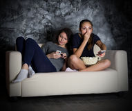 Two girls looks TV Stock Photo