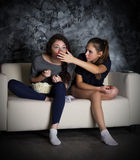 Two girls looks TV Stock Photography