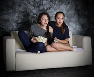 Two girls looks TV Royalty Free Stock Images
