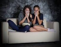 Two girls looks TV Stock Photo