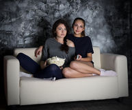 Two girls looks TV Royalty Free Stock Image