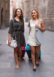 Two girls with luggage at street Royalty Free Stock Photos