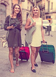 Two girls with luggage at street Stock Photography