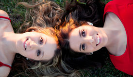 Two girls lying in the countryside Stock Image