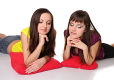 Two girls lying on the floor Stock Photo