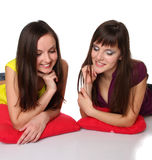 Two girls lying on the floor Royalty Free Stock Images