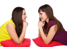 Two girls lying on the floor Royalty Free Stock Photography