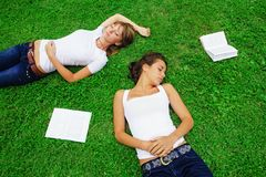 Two girls lying on grass Royalty Free Stock Photography