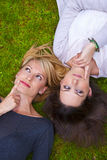 Two girls lying in the grass Royalty Free Stock Images