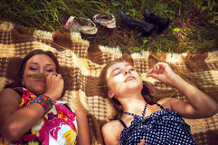 Two girls lying on the grass Royalty Free Stock Photography