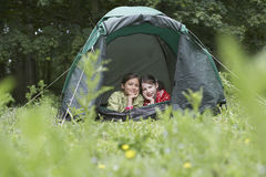 Two Girls Lying In Tent Stock Photography