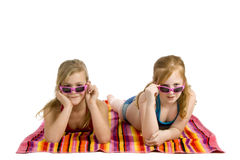 Two girls lying on a towel Royalty Free Stock Photography