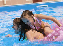 Two girls make merry in a pool Stock Photo