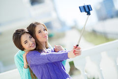 Two girls make self in the city Stock Photos