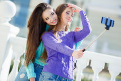 Two girls make self in the city Stock Images