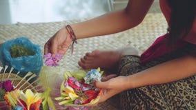 Two girls making balinese offerings Canang sari. Slide stock video
