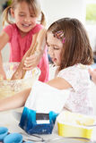 Two Girls Making Cupcakes In Kitchen Royalty Free Stock Images