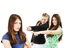 Two girls making fun of a girl royalty free stock photo