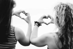 Two girls making heart shape Royalty Free Stock Images