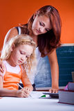 Two girls making homework Stock Image
