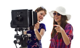 Two girls making photos Royalty Free Stock Image