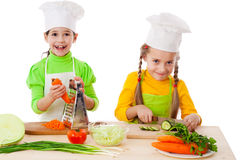 Two girls making salad Stock Images