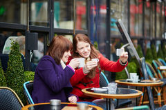 Two girls making self picture (selfie) Royalty Free Stock Photos
