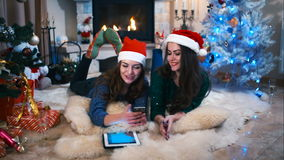 Two girls making selfie near the Christmas tree stock footage